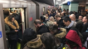 Commuters jam subway cars and the platform at Museum station on the TTC subway line in Toronto, Thursday, Jan.24, 2019. THE CANADIAN PRESS/Graeme Roy