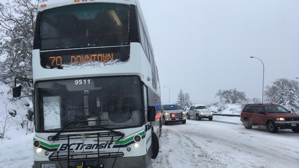 Two BC Transit buses became stuck in the snow on the Pat Bay Highway near the Royal Oak exit Tues., Feb. 12, 2019. (CTV Vancouver Island)