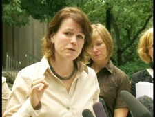 Christine Star, a member of one of the families impacted by the collapse of Imagine Adoption, speaks after meeting with Ontario government officials in Toronto on Friday, July 24, 2009.