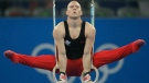 Canada's gymnast Kyle Shewfelt performs at the rings during the men's qualification rounds at the Beijing 2008 Olympics in Beijing, Saturday, Aug. 9, 2008. (THE CANADIAN PRESS / AP, Matt Dunham)