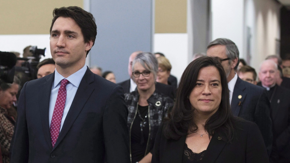 Prime Minister Justin Trudeau and Minister of Justice and Jody Wilson-Raybould take part in the grand entrance as the final report of the Truth and Reconciliation commission is released, Tuesday Dec. 15, 2015 in Ottawa. (THE CANADIAN PRESS/Adrian Wyld)