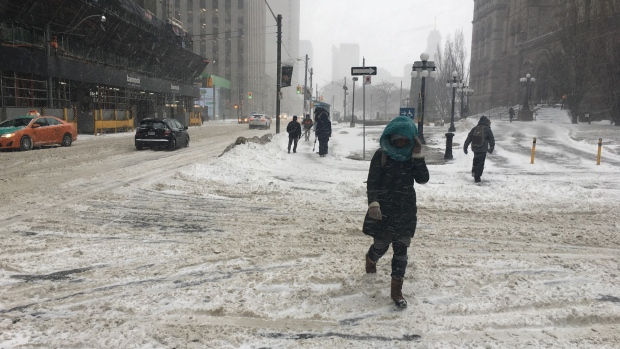 Crews clean up around the city after winter storm on Tuesday