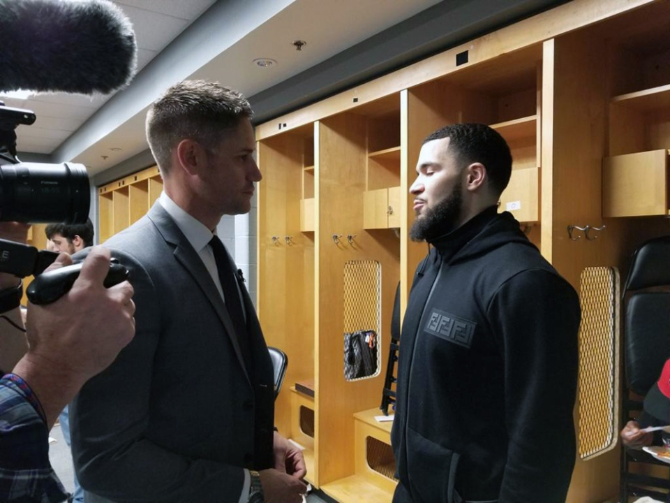 Akman speaks with VanVleet in the locker room.