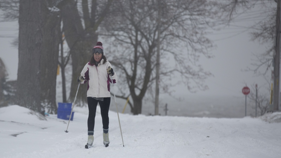 High school teacher Melissa Watson takes advantage of a snow day by cross-country skiing on the streets in Burlington, Ont. on Tuesday, February 12, 2019. A winter storm brought snow, freezing rain, and high winds to the region causing cancellations and hazardous conditions. THE CANADIAN PRESS/Peter Power