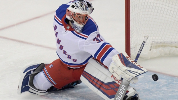 2f00b821c5a New York Rangers goaltender Marek Mazanec deflects the puck during the  third period of an NHL hockey game against the New Jersey Devils