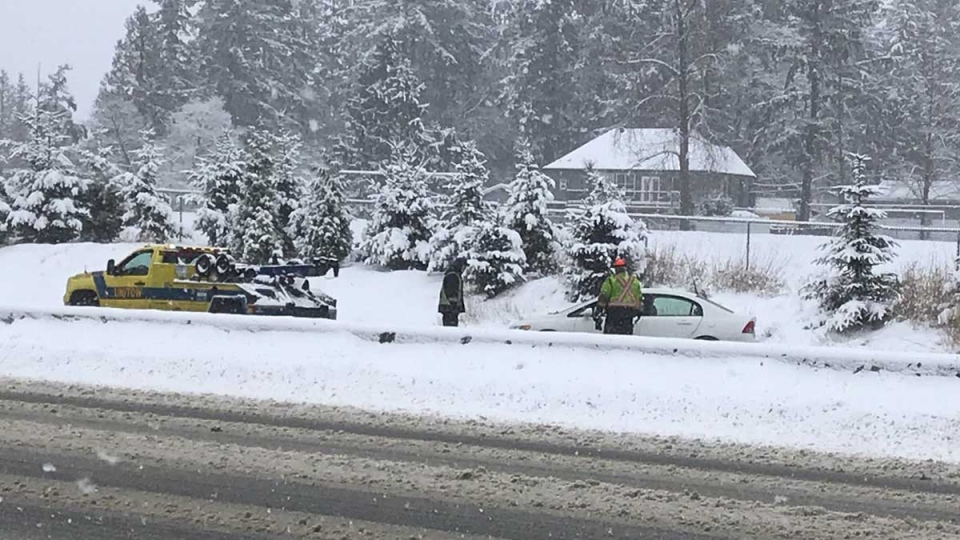 A car is seen in the ditch of Highway 1 on Tuesday, Feb. 12, 2019. (Peter Bremner / CTV Vancouver)