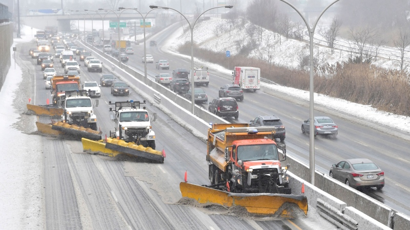 A line of snow plwos clears the gardiner Expressway in Toronto on Tuesday, Feb.12, 2019 after a winter storm hit the region. A huge winter storm is sweeping across Ontario and bringing everything from freezing rain to high winds with it. THE CANADIAN PRESS/Frank Gunn