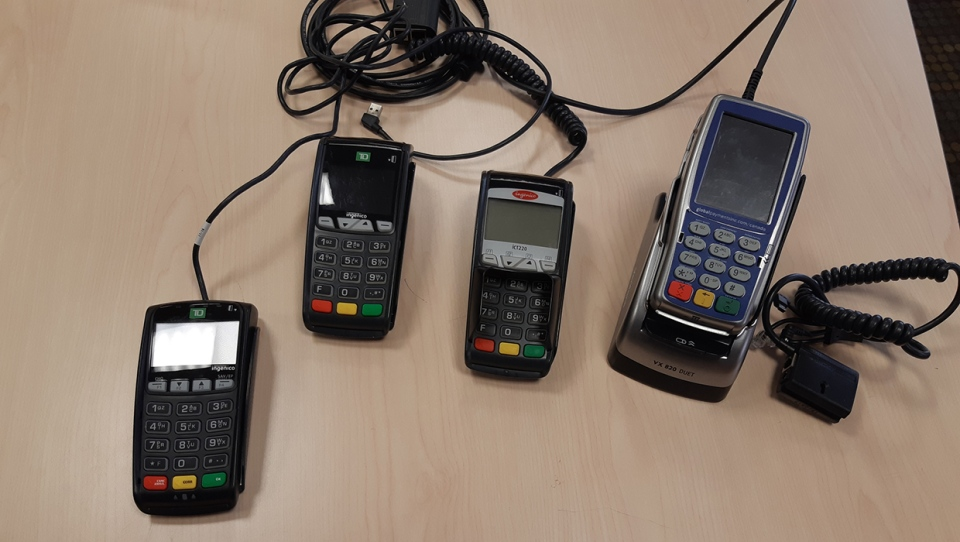 Several debit machines and card making equipment was found in the apartment.