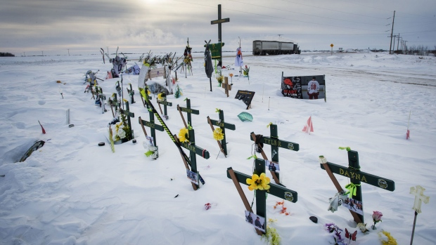 Lawyers for a proposed class action waiting for certification plan to ask a judge Friday to delay another lawsuit filed by five of the Humboldt Broncos victims' families until that's done. (file)