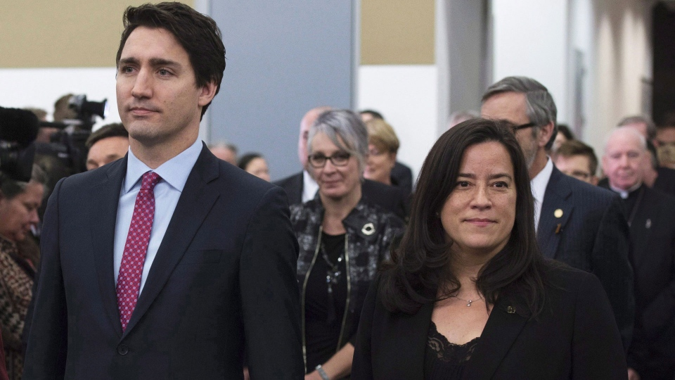 Prime Minister Justin Trudeau and former Minister of Justice and Attorney General of Canada Jody Wilson-Raybould take part in the grand entrance as the final report of the Truth and Reconciliation commission is released, Tuesday December 15, 2015 in Ottawa. THE CANADIAN PRESS/Adrian Wyld