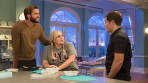 "This image released by Warner Bros. Pictures shows Liam Hemsworth, from left, Rebel Wilson and Adam Devine in a scene from ""Isn't It Romantic."" (Michael Parmelee/Warner Bros. Pictures via AP)"