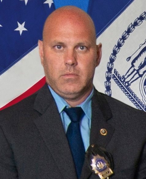 In this undated photo provided by the New York City Police Department, Det. Brian Simonsen is shown. New York Police Commissioner James O'Neill told the media during a news conference that Simonsen was shot and killed by friendly fire Tuesday night, Feb. 12, 2019, while responding to a report of an armed robbery at a T-Mobile store in the Richmond Hill section of Queens. (New York City Police Department via AP)