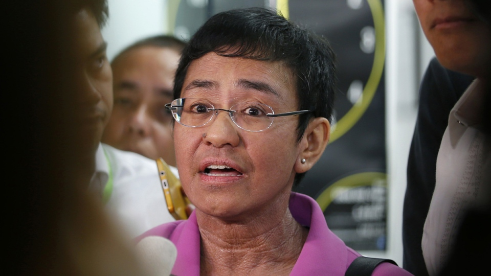 Maria Ressa, CEO of the online news agency Rappler, talks to reporters on Jan. 22, 2018. (Bullit Marquez / AP)