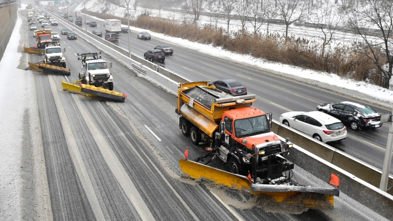 A line of snow plows clears the Gardiner Expressway in Toronto on Tuesday, Feb.12, 2019 after a winter storm hit the region. THE CANADIAN PRESS/Frank Gunn