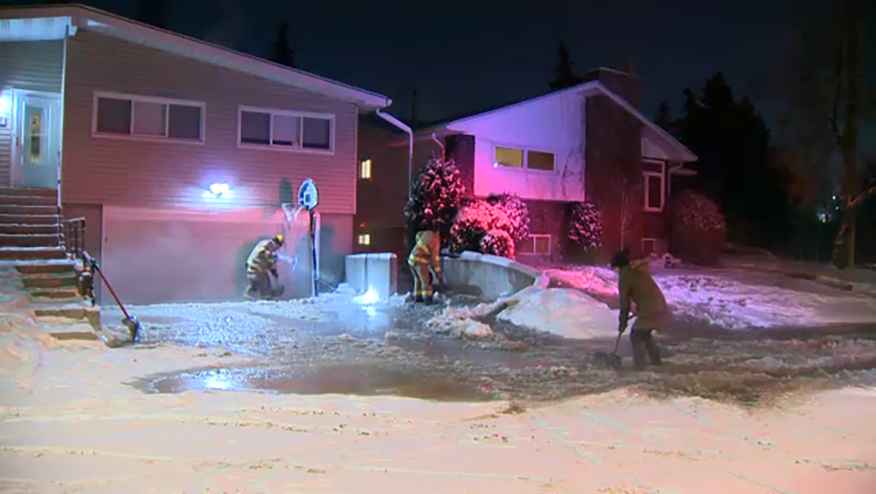 Water quickly turned to ice on a northwest street after a water pipe burst.