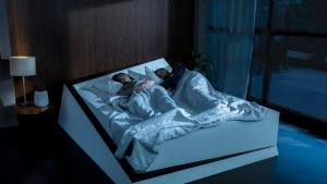 Ford wants to put its lane-monitoring vehicle technology in your bedroom. The automaker has developed a new concept bed which uses a conveyor belt to return people hogging too much mattress space to their side of the bed. (Ford)