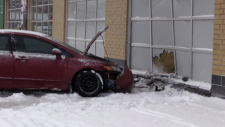 A vehicle after a crash into the window of an LCBO
