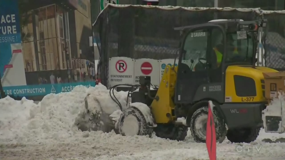 A small snow plow clears snow in Montreal on Feb. 13, 2019.