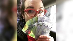 Kirbie Humber is shown with her winnings in his undated photo. (Kirbie Humber)