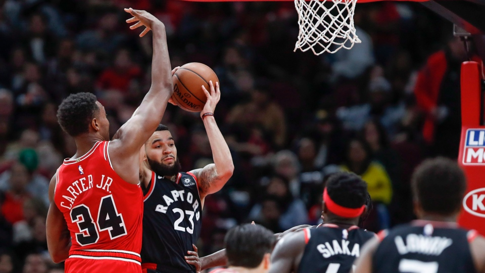 Toronto Raptors guard Fred VanVleet looks to pass the ball during the second half of his first NBA basketball game as a starter on Saturday, Nov. 17, 2018, in Chicago. (AP Photo/Kamil Krzaczynski)