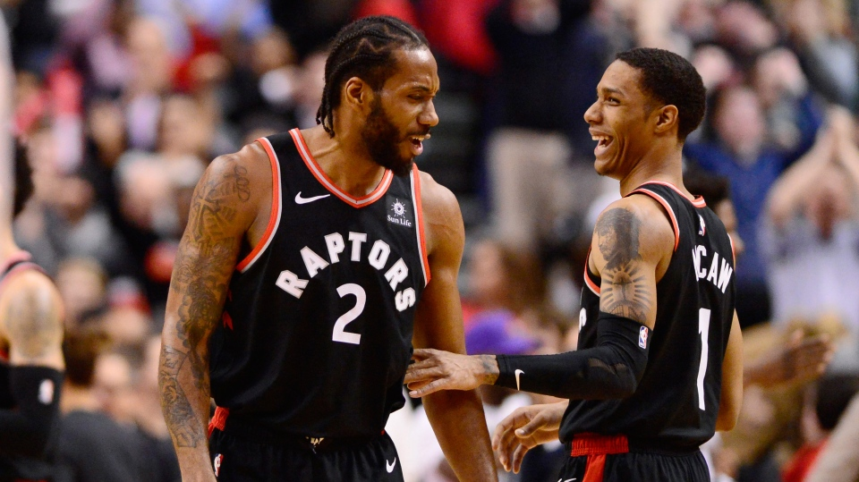 Toronto Raptors forward Kawhi Leonard (2) and teammate guard Patrick McCaw celebrate their victory over the Brooklyn Nets in NBA basketball action in Toronto on Monday, Feb. 11, 2019. THE CANADIAN PRESS/Frank Gunn