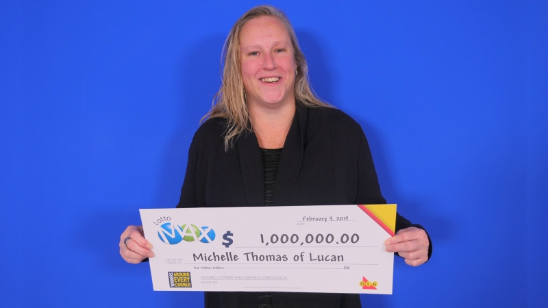 Michelle Thomas of Lucan, Ont. is seen holding her million-dollar cheque in this image provided by the Ontario Lottery and Gaming Corporation.