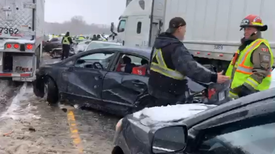 OPP, Halton police and firefighters at the scene of a multi-car pile-up on westbound Highway 401 in Milton on Feb. 13, 2019. (Source: Twitter/Kerry Schmidt)