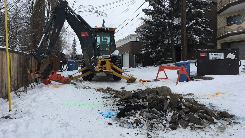 Crews are working in an alley near Confederation Park to repair a water pipe that burst early Wednesday morning.