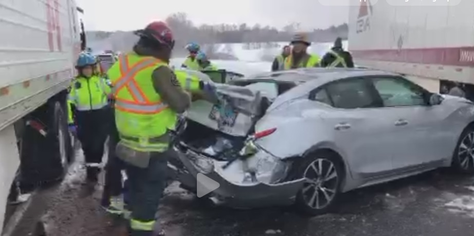 Firefighters tend to a damaged vehicle on Highway 401 near Milton on Feb. 13, 2019. (Kerry Schmidt/Twitter)