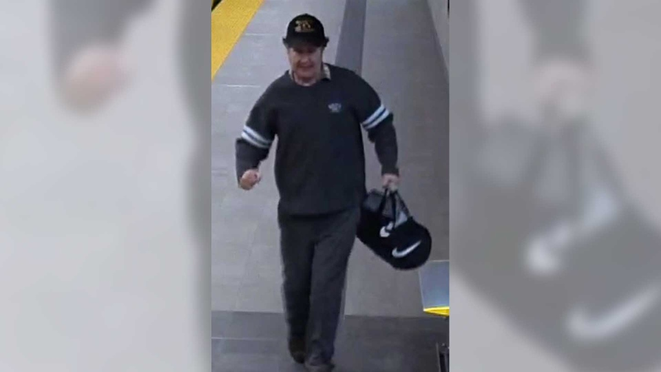 The suspect in an alleged groping of a 7-year-old girl is seen at a SkyTrain station. (Metro Vancouver Transit Police)