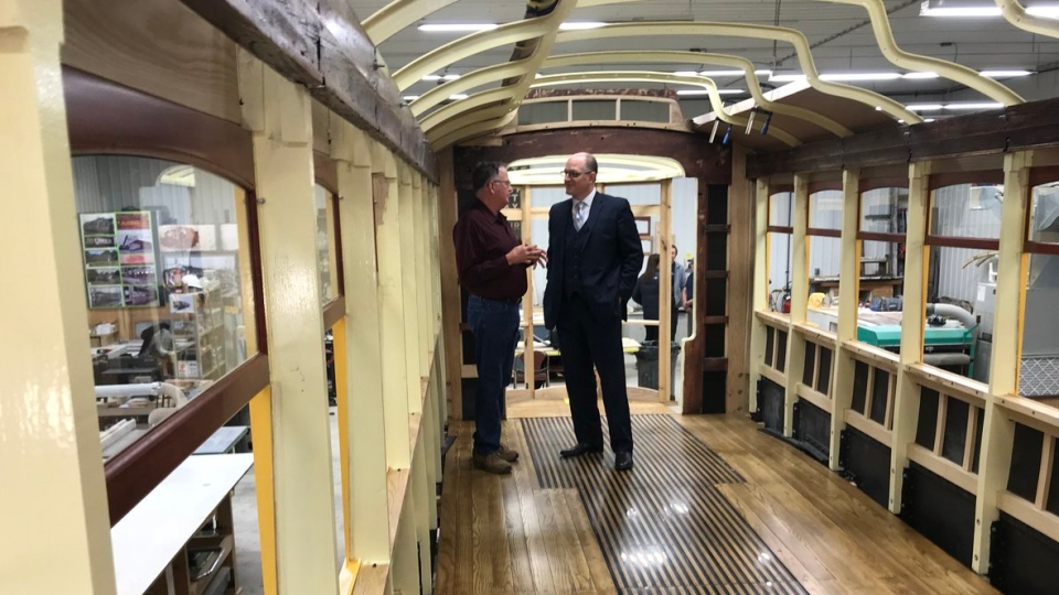 Windsor mayor Drew Dilkens is checking out the progress on the city's $750,000 investment into the restoration of Streetcar #351 in Blenheim, Ont., on Wednesday, Feb. 13, 2019. (Rich Garton/ CTV Windsor)
