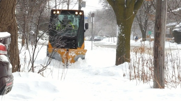 City plowing sidewalks in Guelph