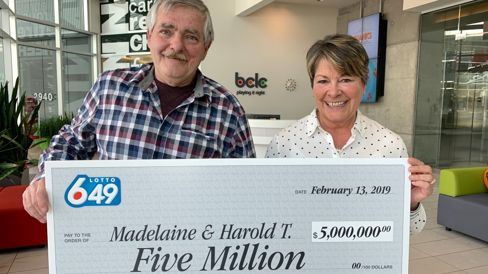 Harold and Madelaine Thomas show off their winnings in Vancouver on Wednesday, Feb. 13, 2019. (Adnan Hussain / CTV Vancouver)