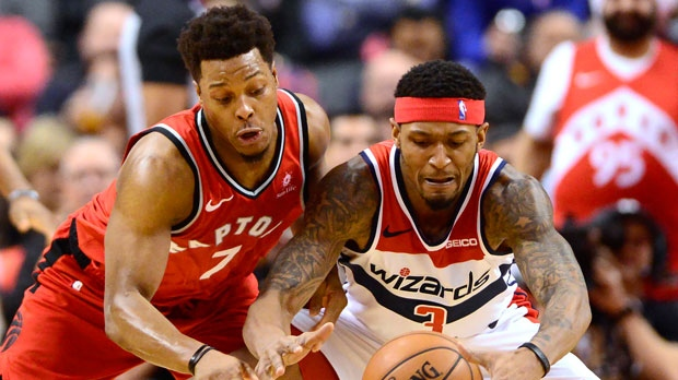 Toronto Raptors guard Kyle Lowry (7) and Washington Wizards guard Bradley Beal (3) battle for the ball during first half NBA basketball action in Toronto on Wednesday, February 13, 2019. THE CANADIAN PRESS/Frank Gunn