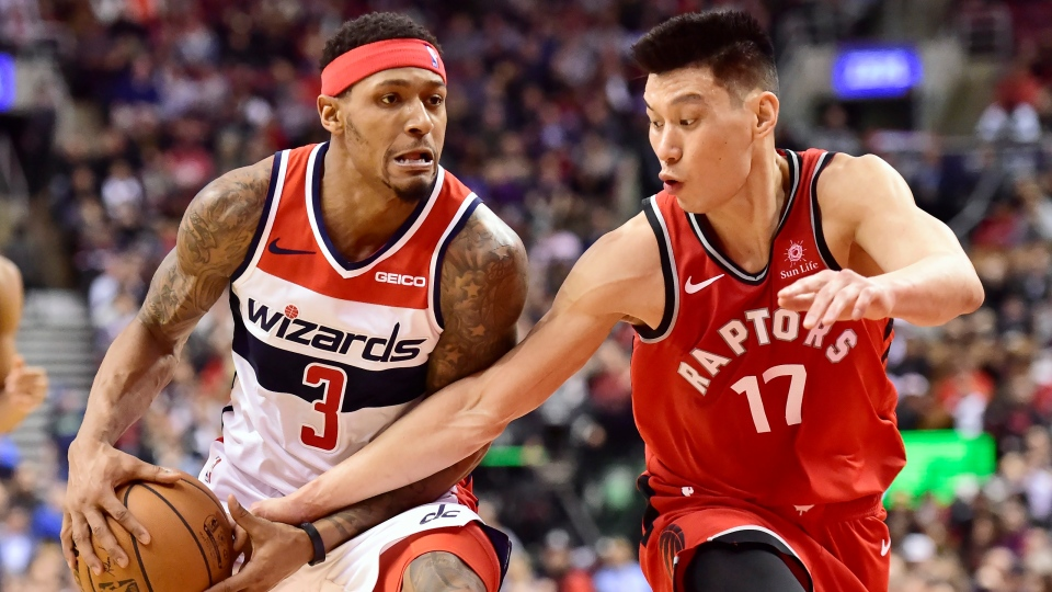 Toronto Raptors guard Jeremy Lin (17) tries to steal the ball from Washington Wizards guard Bradley Beal (3) during second half NBA basketball action in Toronto on Wednesday, February 13, 2019. THE CANADIAN PRESS/Frank Gunn