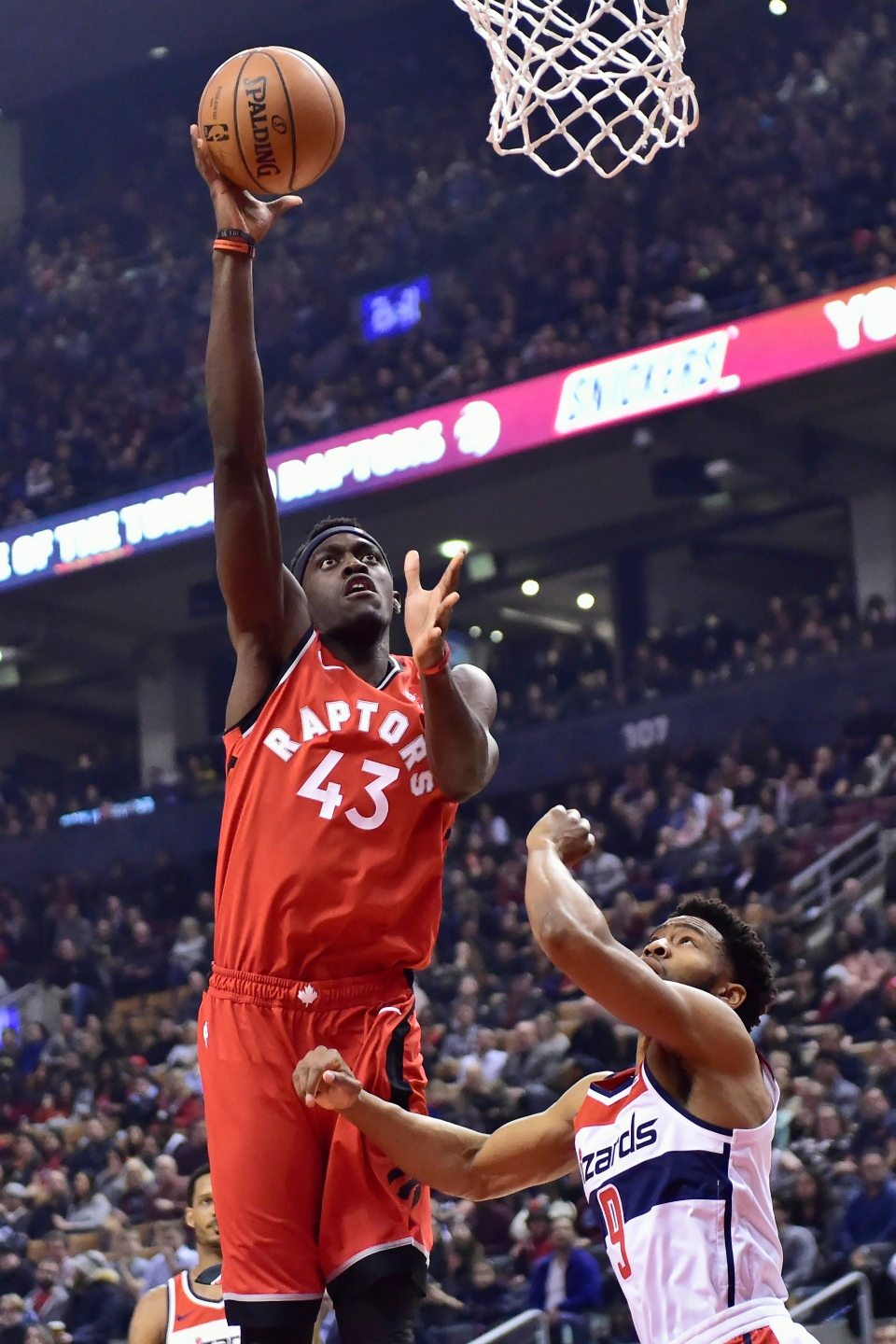 Toronto Raptors forward Pascal Siakam (43) scores over Washington Wizards guard Chasson Randle (9) during first half NBA basketball action in Toronto on Wednesday, February 13, 2019. THE CANADIAN PRESS/Frank Gunn
