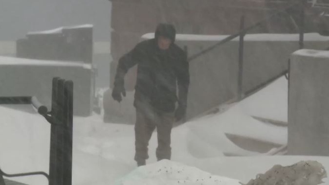 Dennis Oland trudges through a blizzard to the Saint John Law Courts for his murder trial on Feb. 13, 2019.