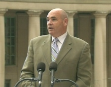 Deputy Ontario Premier George Smitherman speaks outside of Union Station in Toronto, Friday, July 24, 2009.