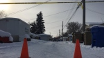 Police are blocking an alley in North Central Regina (Creeson Agecoutay / CTV Regina)