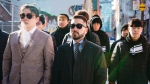 Head coach Beoumjun (Bishop) Lee, left, GM Jaesun (Jae) Won, centre, walk with members of the Toronto Defiant during a recent visit to Toronto. The esports team opens play Friday in the Overwatch League.(The Toronto Defiant)