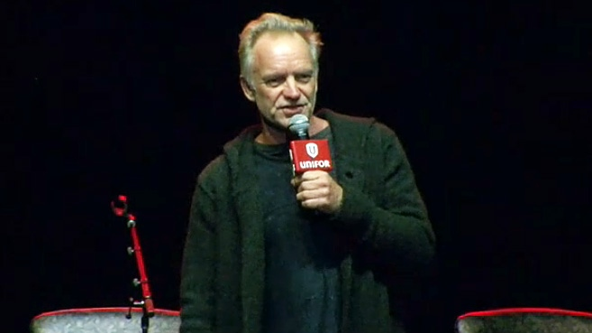 Holding a Unifor branded microphone, Sting performs alongside the Toronto cast of his musical 'The Last Ship' for GM workers in Oshawa on Feb. 14, 2019.