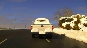 Mounties pulled over a Nanaimo driver whose truck was completley obscured by snow, issuing him a $109 fine. (Nanaimo RCMP)