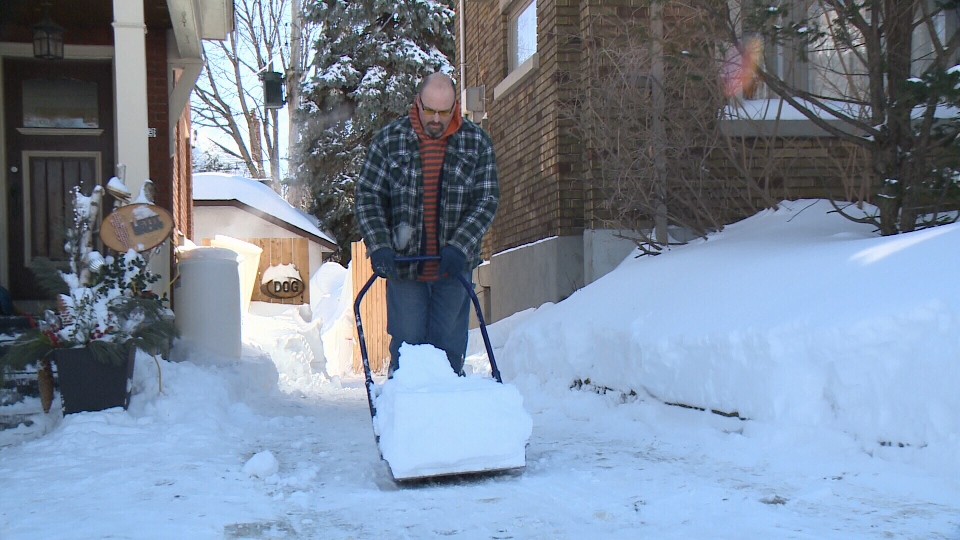 Mitch Plouffe takes his time shovelling.