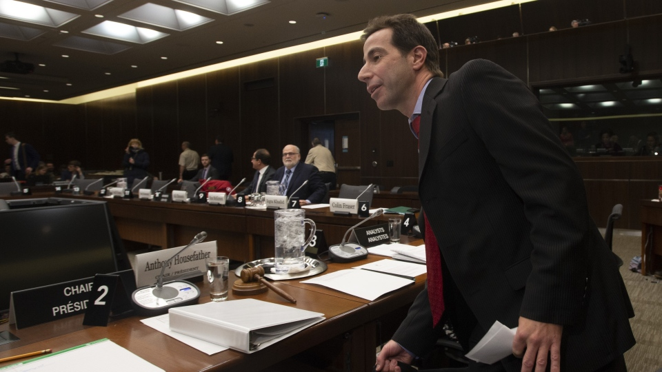 Chair Anthony Housefather puts his briefcase down as he arrives for a meeting of the House Justice and Human Rights Committee in Ottawa, Wednesday February 13, 2019. THE CANADIAN PRESS/Adrian Wyld