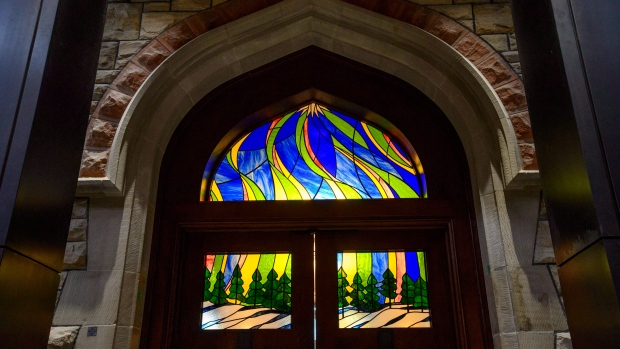 Stained glass work on the entrance doors to the new temporary House of Commons is viewed prior to a ceremonial handover marking the completion of the historic restoration and modernization of the West Block and the new visitor welcome centre on Parliament Hill Ottawa on Thursday, Nov. 8, 2018. The stained glass was designed by the Dominion Sculptor of Canada Phil White. THE CANADIAN PRESS/Sean Kilpatrick