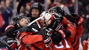 Teammates congratulate Canada goalie Genevieve Lacasse (31) after defeating USA in National Women's Team Rivalry Series hockey in Toronto on Thursday, February 14, 2019. THE CANADIAN PRESS/Frank Gunn