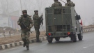 Indian army soldiers arrive at the site of Thursday's explosion in Pampore, Indian-controlled Kashmir, Friday, Feb. 15, 2019. (AP Photo/Dar Yasin)