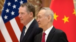U.S. Trade Representative Robert Lighthizer, left, and Chinese Vice Premier Liu He arrive for a group photo at the Diaoyutai State Guesthouse in Beijing, Friday, Feb. 15, 2019. (AP Photo/Mark Schiefelbein, Pool)