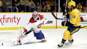 Nashville Predators right wing Ryan Hartman (38) scores a goal against Montreal Canadiens goaltender Carey Price in the second period of an NHL hockey game Thursday, Feb. 14, 2019, in Nashville, Tenn. (AP Photo/Mark Humphrey)