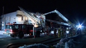 Firefighters battle a two-alarm fire on Notre Dame Blvd. in Montreal East on Feb. 15, 2019 (CTV Montreal/Cosmo Santamaria)